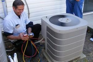 Expert inspecting heat pump