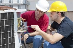 Technicians repairing AC unit